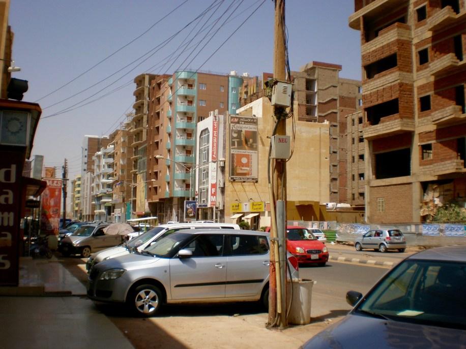 Stark contrast between older apartments...