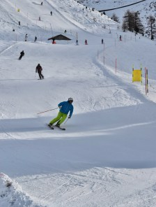 A skier skiing down the slope in Zermatt