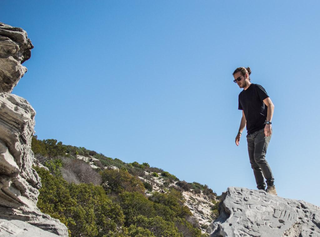 Exploring the boulders near the lagoon