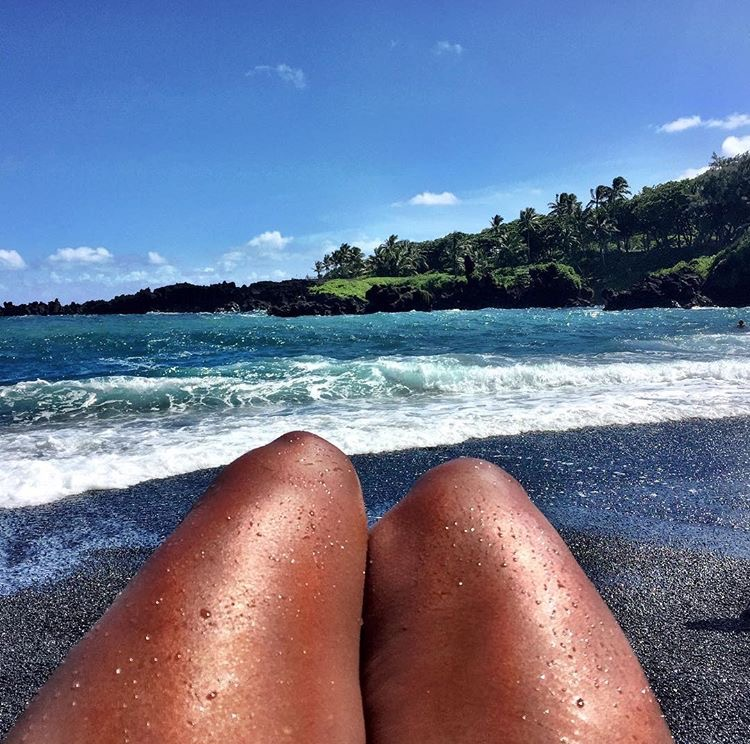 Photo of my legs at black sand beach