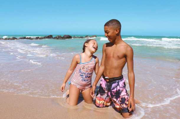 Biracial kids on Condado Beach in Puerto Rico