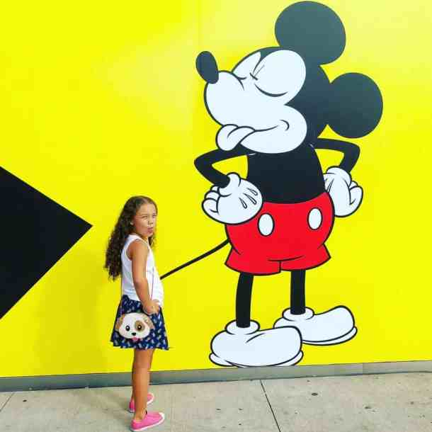 My daughter outside of the My Disney Experience in New York City