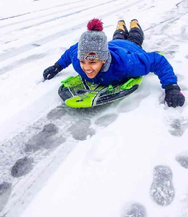 biracial son sledding