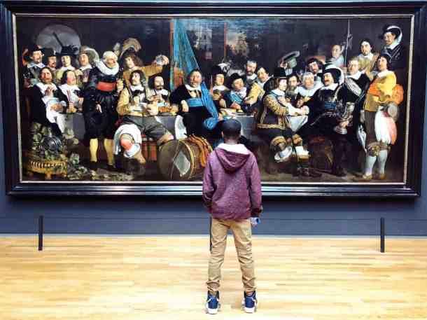 Teenage boy at Rijksmuseum in Amsterdam