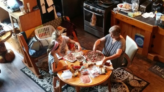 The girls make pizza with Grammie