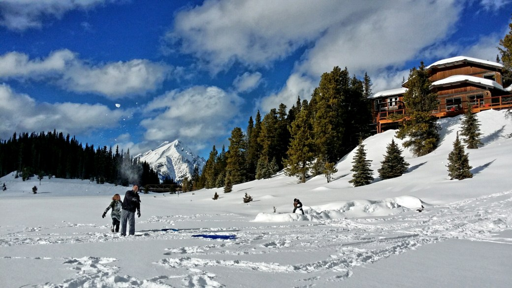 Snowballs, snow forts and sliding in the sun.  Family time at Mount Engadine Lodge.
