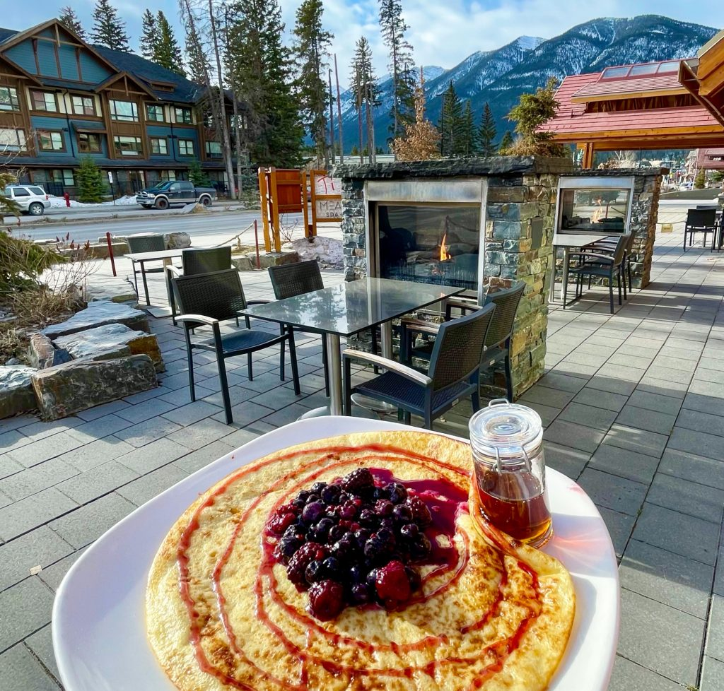 Outdoor Patio Space at Pacini, Moose Hotel & Suites Banff