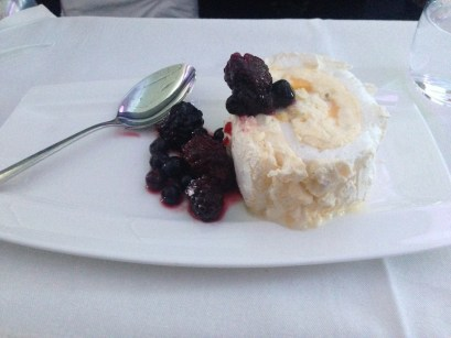 Lemon and Lime Meringue Roulade with mixed berries.