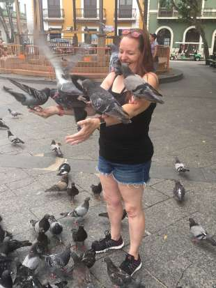 Feeding pigeons in Old San Juan
