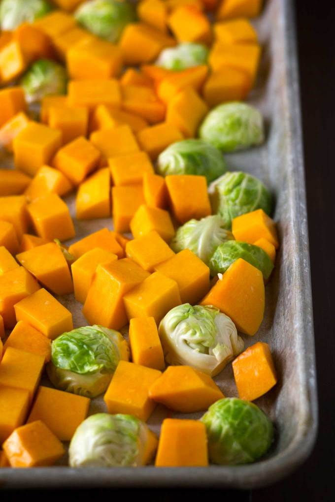 Fall Roasted Vegetables   Roasted butternut squash, brussels sprouts, sprinkled with pomegranate arils   Easy Vegan Side Dish   https://passtheplants.com