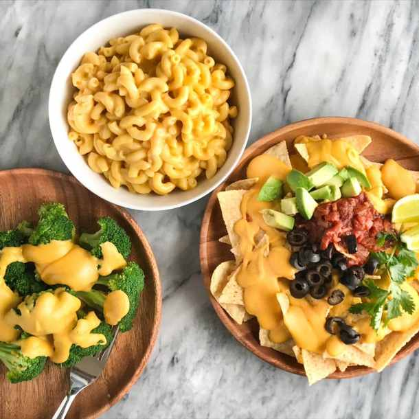 Protein-Packed Vegan Cheese Sauce | Plate of broccoli with vegan cheese sauce on top, bowl of vegan macaroni and cheese, plate of nachos with vegan cheese sauce | Whole foods plant based | Oil-free | #plantbased #vegan #oilfree #wfbp | https://passtheplants.com/
