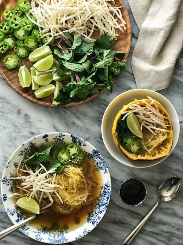 Spaghetti Squash Vegan Pho   Pho in bowls with toppings of mung bean sprouts, lime, jalapeño, thai basil   https://passtheplants.com/