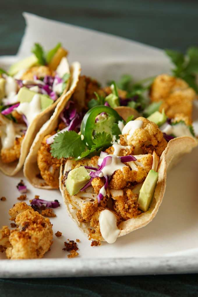Close-up of Chipotle Cauliflower Tacos on baking sheet