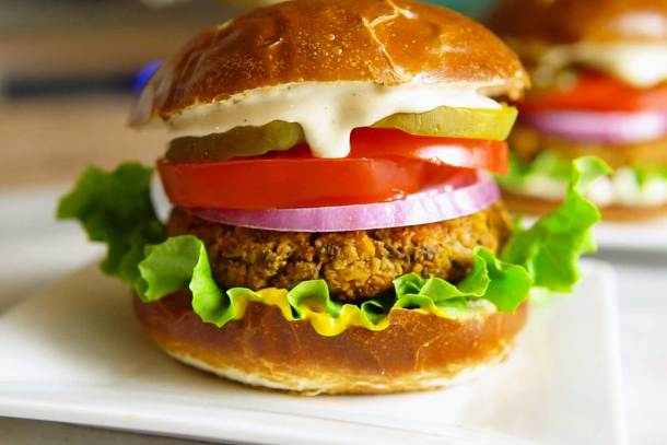 vegan veggie burger with toppings on a plate