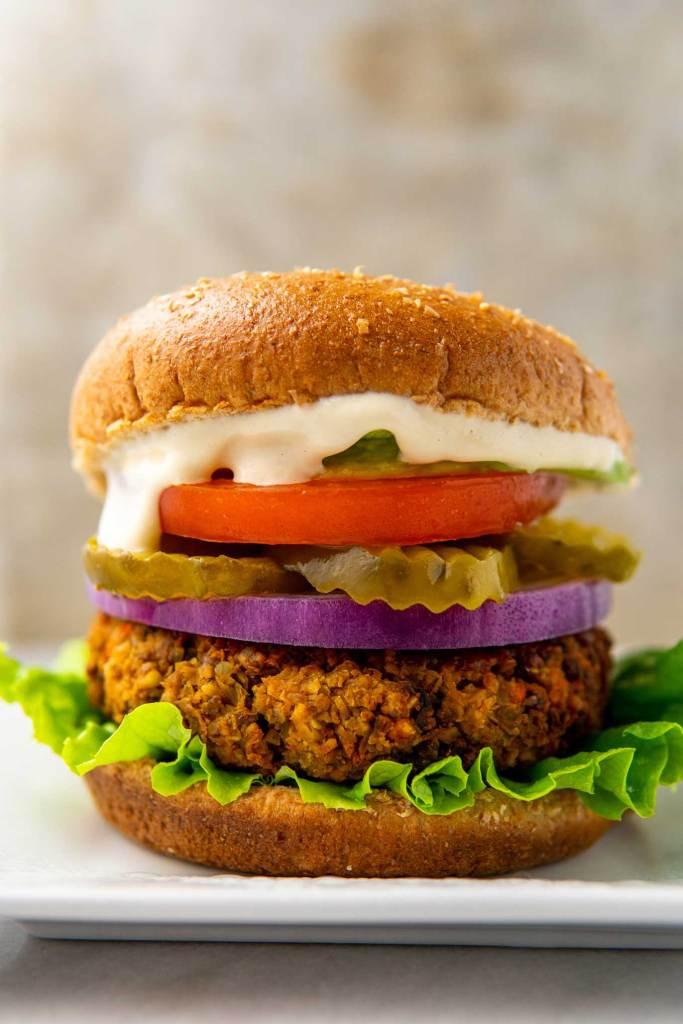 Vegan veggie burger on a bun with toppings