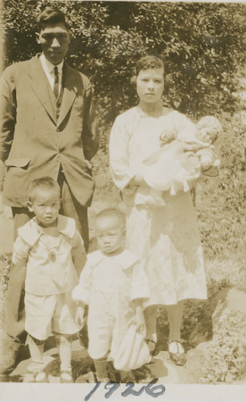 Photo of Kew Sheck and Wai Ming Yip, with 3 sons, about 1926.