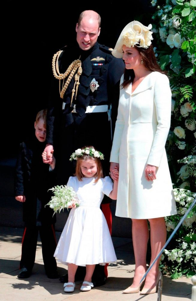 William e Kate con George e Charlotte al Royal wedding di Harry e Meghan, foto Andrew Matthews/Press Association