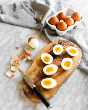 Jammy soft boiled eggs on cutting board