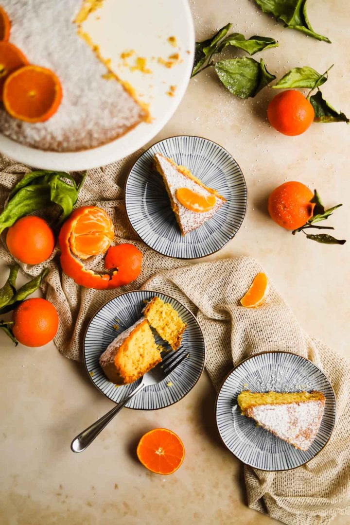 vibrant Clementine olive oil cake slices on small blue plates