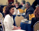 Gilbert chats at her table during the luncheon