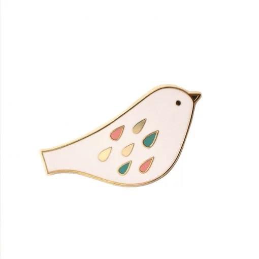 Pin's oiseau Mini Labo poudre