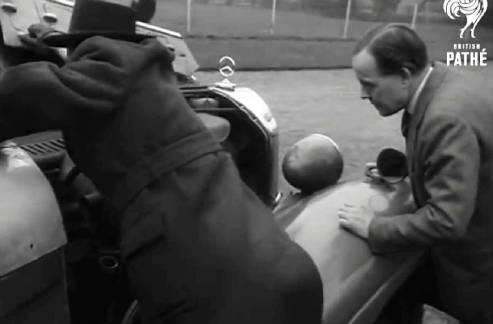 Raymond Way inspecting one of Hermann Goering's custom armoured cars, which he bought and exhibited.