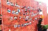 O mural com fotos oficiais do evento