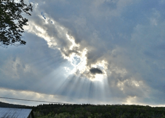 sun coming out of clouds