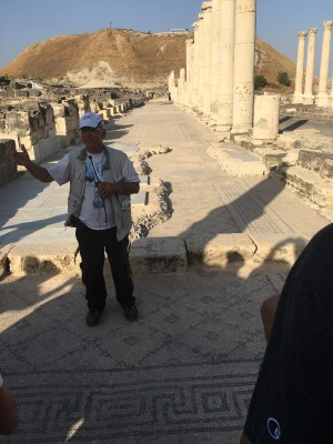 Our tour guide Arie standing on the Mosaic paving and right in front of the marble overlay.