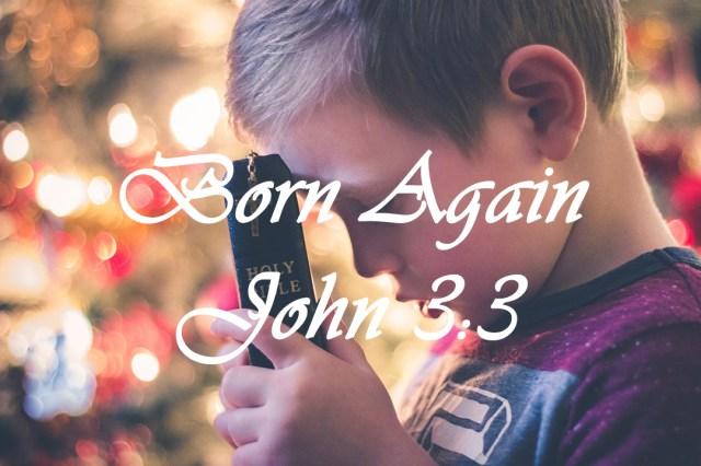 Boy holding Bible and praying