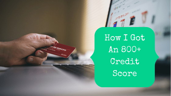 Picture of a hand holding a credit card with blog post title: How I Got An 800+ Credit Score