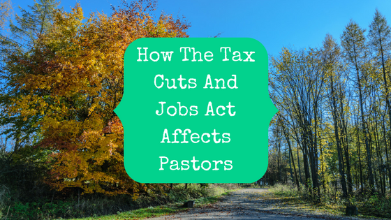 Picture of an orange tree next to a country road with blog post title: How the Tax cuts and jobs act affects pastors