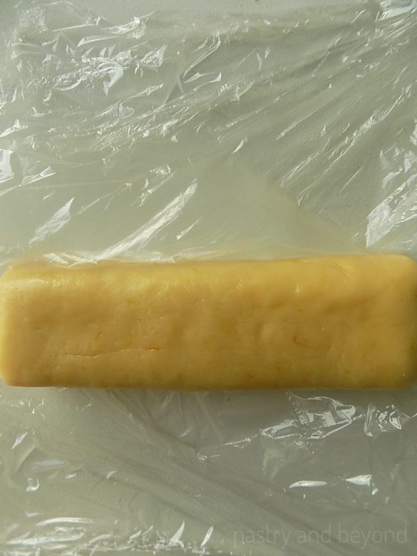 Steps of making lemon slice-and bake cookies: Making a log out of the dough