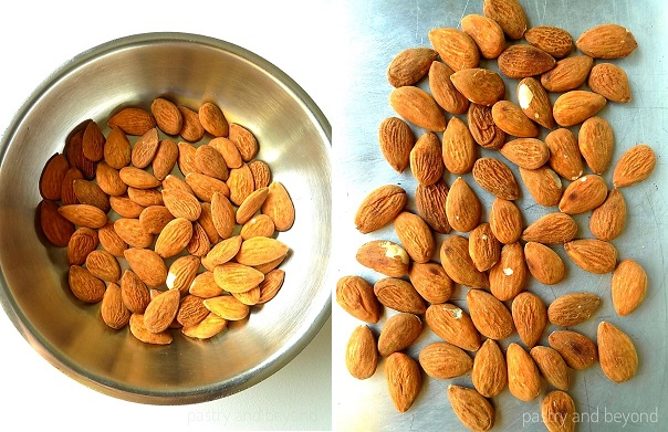 Toasting the almonds in a pan and then spreading on a baking sheet.
