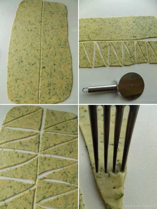 Steps of Making Dill Crackers: Rolling out the dough and dividing in half vertically. Making triangles with a pizza cutter, pricking the triangles with a fork.