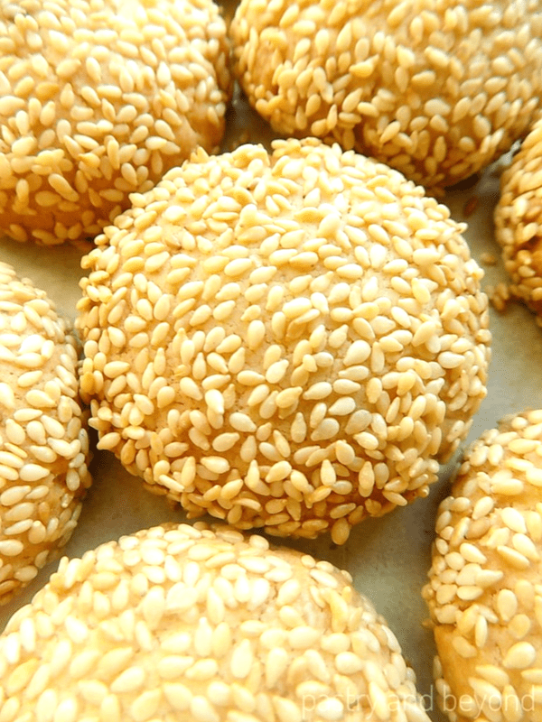 Sesame cookies on a white surface.