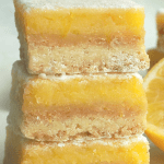 Stacked lemon curd bars.