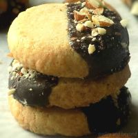 Stacked shortbread almond extract cookies.