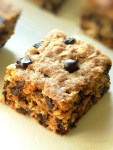 Oatmeal chocolate chip bar on a white surface.
