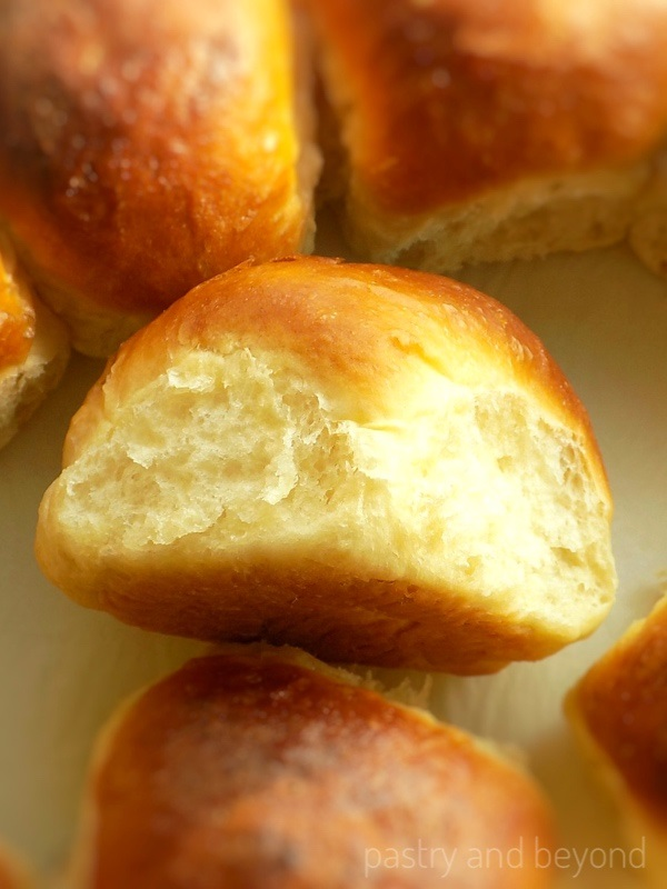 Soft Dinner Rolls on a parchment paper.