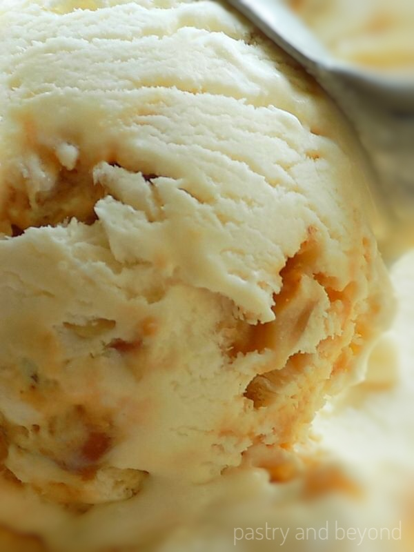 Showing hazelnut praline ice cream while scooping.