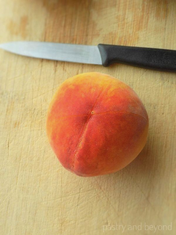 "How to Peel Peaches: Making a ""X""sign on the bottom of a peach"