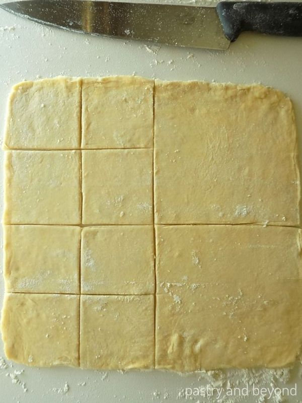 After cutting the dough into 4 equal pieces, keeping one side as it is and cutting each other 2 squares into 4 and make 8 small squares..
