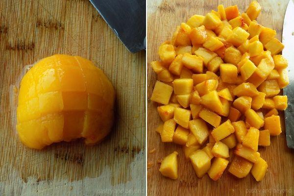 Chopping the peaches on a cutting board.