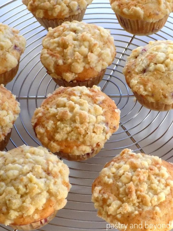 Raspberry crumble muffins on a wire rack to cool.