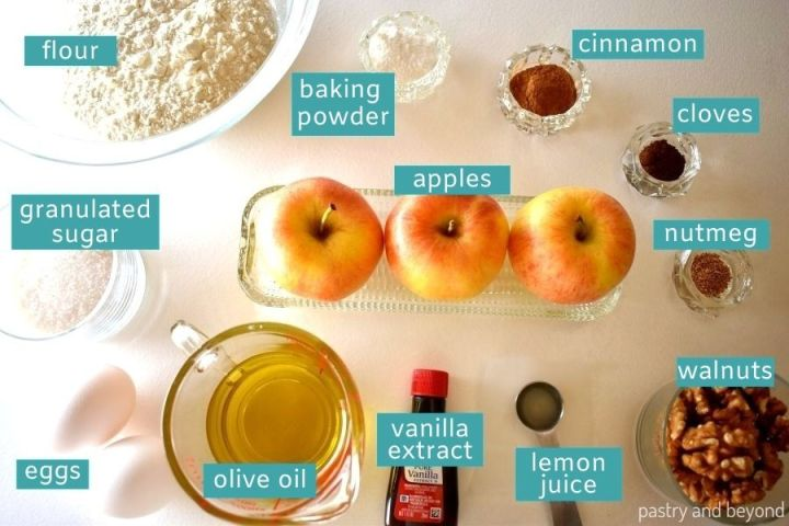 Ingredients for apple cake loaf on a white surface.
