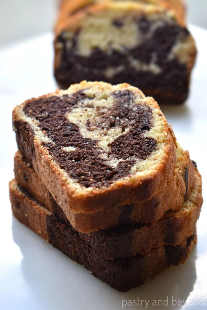 Stacked marble cake loaf slices.