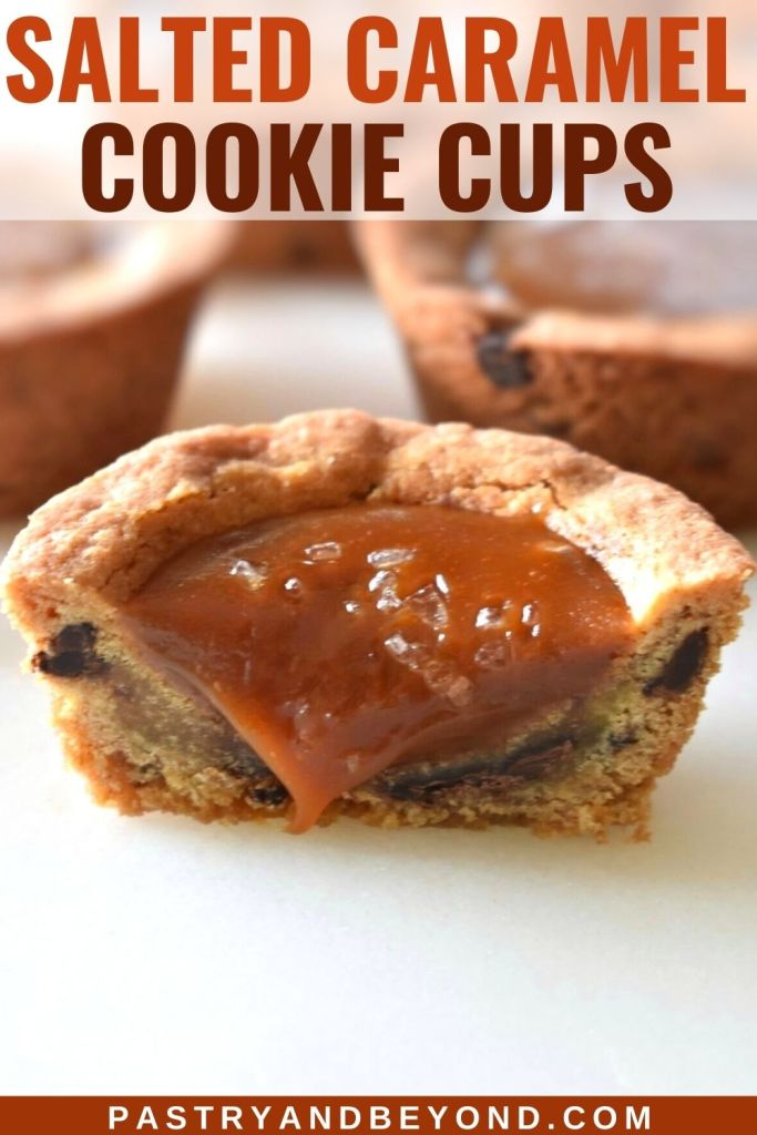 Half of chocolate chip cookie cup that is filled with caramel sauce and sea salt.