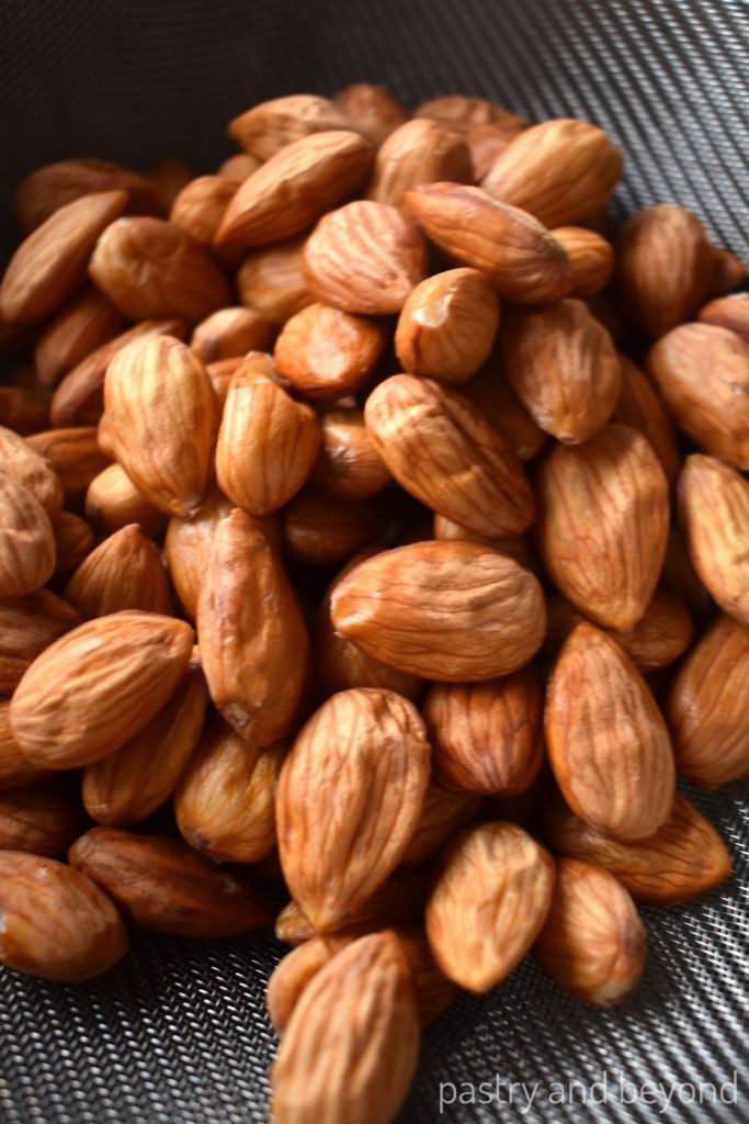 Almond in a colander with a shrivel skin.
