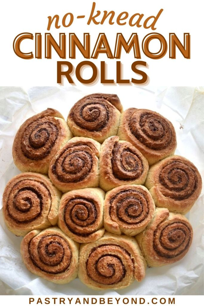 Cinnamon rolls in a round dish with text overlay.